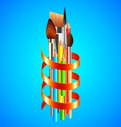 Art tools wrapped with red ribbon on blue vector