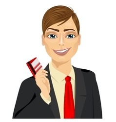 Businessman with glasses holding a red credit card vector