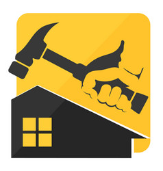 hammer in hand and a house symbol vector image