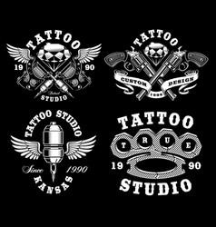 set monochrome tattoo emblems on dark vector image