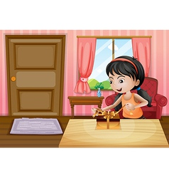 A girl opening her gift inside the house vector image vector image