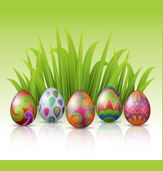 decorated easter eggs with green grass background vector image