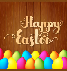 lettering happy easter on wooden background vector image