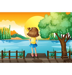 A girl standing facing at the river vector image