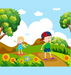 Boy and girl hiking on the hill vector