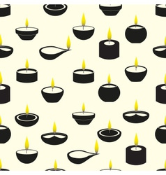 Diwali candles with flame icons seamless pattern vector