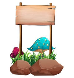 An empty wooden signboard near the big mushrooms vector image vector image