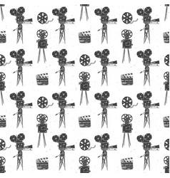 camera film reel and clapperboard vintage vector image