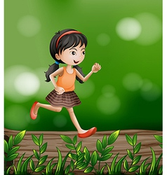 A girl running at the forest vector image vector image