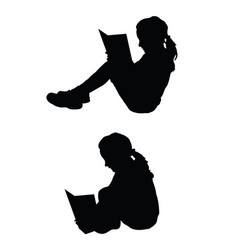 Children reading the book silhouette vector