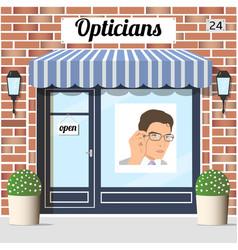 opticians shop building with red bricks facade vector image vector image