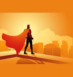 superhero standing on edge a building vector image