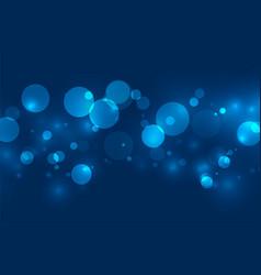 Magical blue bokeh shimmer lights background vector