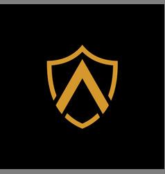 a shield shape gold logo on black background vector image