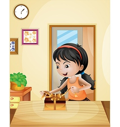 A girl with a gift at the table vector