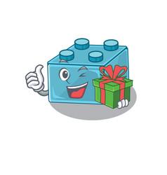 Happy lego brick toys character having a gift box vector