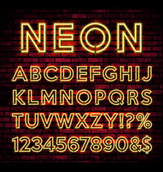 bright neon alphabet on dark brick wall background vector image