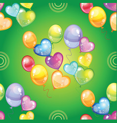 Seamless pattern with colorful balloons on green vector