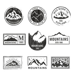 Set of nine mountain travel emblems with grunge vector