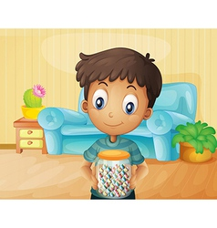 A boy inside the house with jar of candies vector
