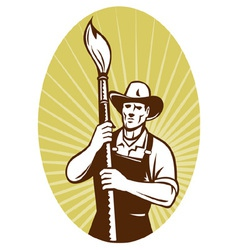 Cowboy painter holding a paint brush facing f vector