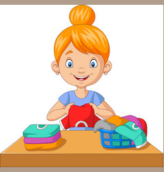 young woman folding clothes vector image