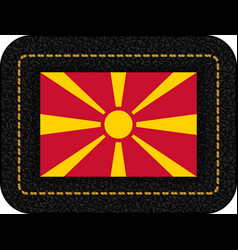 Flag of macedonia icon on black leather backdrop vector