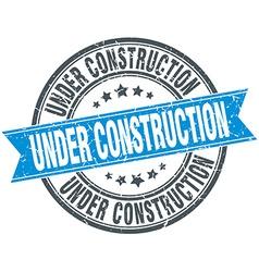 Under construction blue round grunge vintage vector