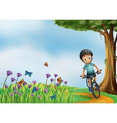 A biker biking at the hilltop with a garden vector