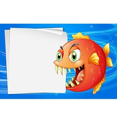 A piranha under the sea beside an empty paper vector image