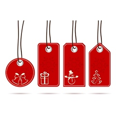 Set of hanging red tags with christmas motifs vector image