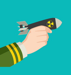 hand holding a rocket nuclear bomb vector image vector image