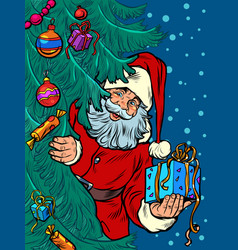 santa claus looks out from behind tree vector image