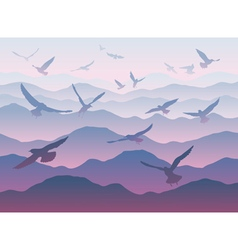 silhouettes flying birds over mountains vector image