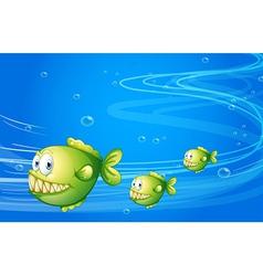 Three green piranhas under the sea vector image