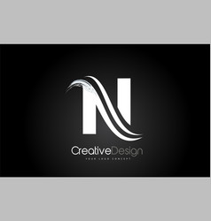 N letter design brush paint stroke on black vector