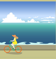 a girl on a bicycle rides along the sea shore vector image