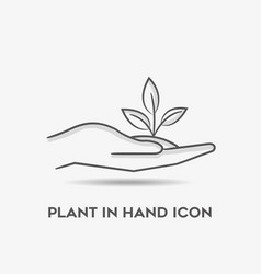 Hand holding plants in outline icon vector