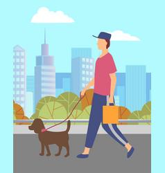 Man walking small dog on leash in city urban park vector