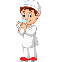 cartoon muslim boy drinking water vector image