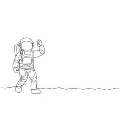 One single line drawing cosmonaut make okay vector