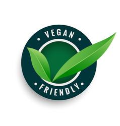 Vegan friendly leaves label in green color vector