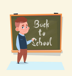 Back to school small boy standing over class board vector