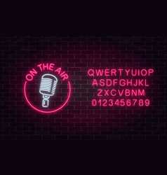 Neon on the air sign with retro microphone in vector