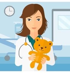 Pediatrician holding teddy bear vector