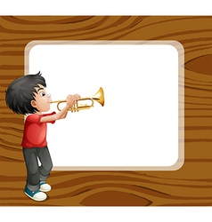 A boy playing with his trombone in front of an vector image vector image
