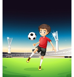 A boy playing soccer alone vector image