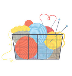 Basket with multi-colored balls of yarn and vector