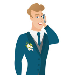 Young caucasian groom talking on a mobile phone vector