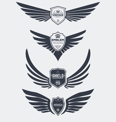 Wings and shields set vector